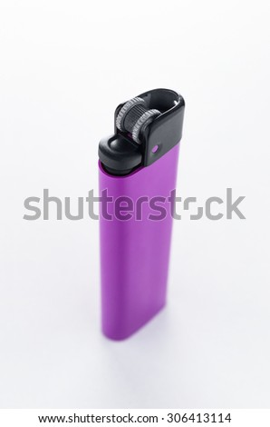 Purple lighter isolated on white background top view - stock photo
