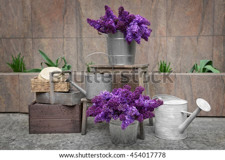 Purple lilac in  metal bucket