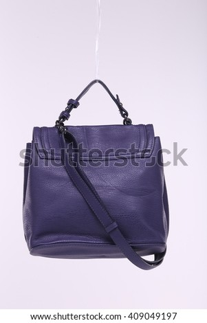 Purple Luxury Expensive Leather hand bag Wallet Purse in Studio Lighting White Background