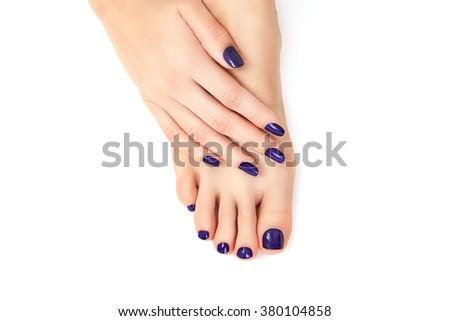 purple manicure and pedicure. Makeup, fashion, beauty. Beautiful female legs with purple pedicure and hands with purple manicure - stock photo