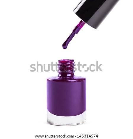Purple nail polish isolated on white. - stock photo