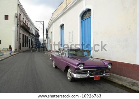purple old american car parked on the street in Matanzas - Cuba - stock photo