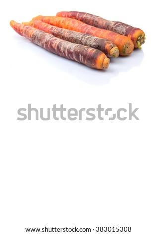 Purple orange carrot variety over white background