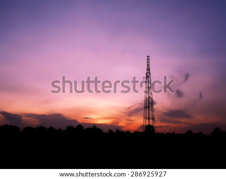 Purple orange dawn with silhouette of antenna tower