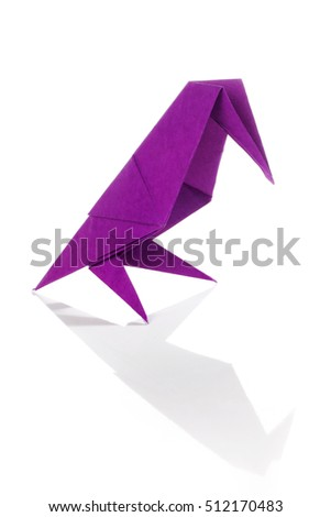Purple origami bird isolated over white background