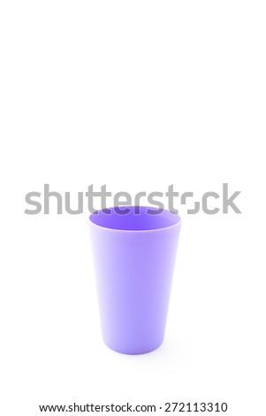 purple plastic cup on white background - stock photo