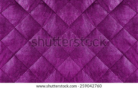 Purple quilted leather fabric close up, abstract background - stock photo