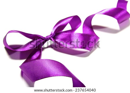 purple ribbon with a bow. Element of design and decoration. Isolated on white background - stock photo