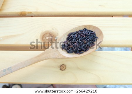 purple rice in spoon - stock photo