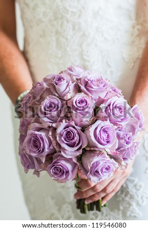 Purple rose bouquet for the bride on her special day. - stock photo