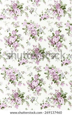 purple rose vintage on fabric background. - stock photo