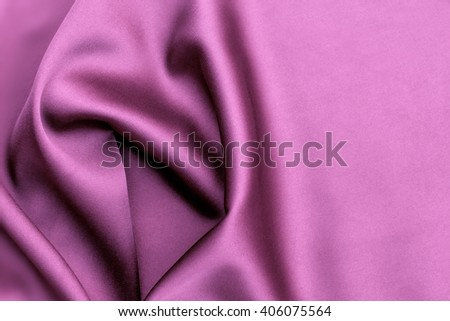 Purple satin background. Smooth elegant pink silk or satin texture can use as background. abstract pink silk background. Deep, rich, purple satin. Folded and flowing background - stock photo