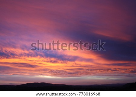 purple sky evening red chemical clouds