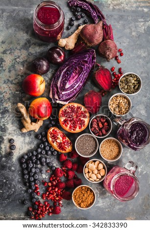 Purple smoothie bowl formula. Clean eating breakfast concept. Various purple and red veggies, fruit and superfoods and cereals ready to prepare smoothie bowl breakfast. Colorful food collage. - stock photo
