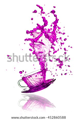 Purple splash out drink from glass on a white background.