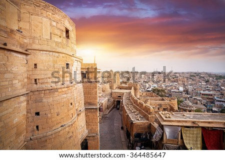 Purple sunset at sandstone desert city with Jaisalmer fort in Rajasthan, India