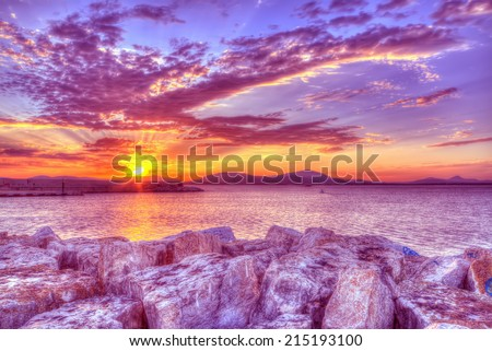 purple sunset in Alghero harbor, Sardinia. hdr tone mapping. - stock photo