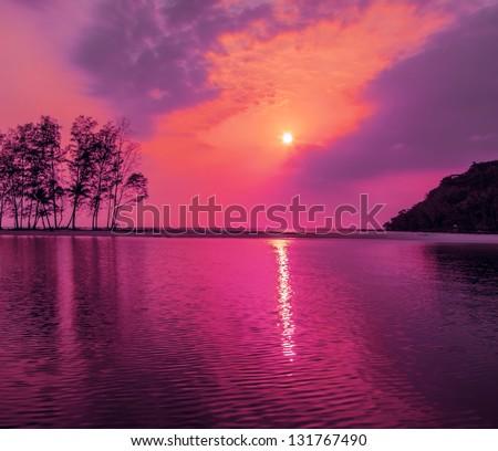 Purple sunset over the sea - stock photo