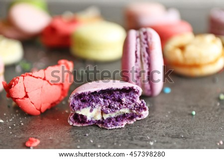 Purple tasty broken macaroon, close up - stock photo