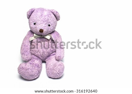 Purple teddy bear on a white background.