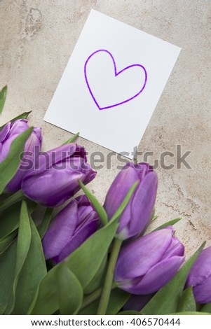 Purple tulips and card with heart shape - stock photo