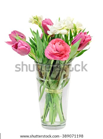 Purple tulips, white freesias, Ranunculus flowers, bouquet, floral arrangement in a transparent vase filled with water, isolated, white background. - stock photo