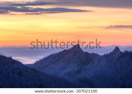 Purple twilight on Unicorn Peak and the foggy Strait of Juan de Fuca and Vancouver Island in Olympic National Park, WA - stock photo