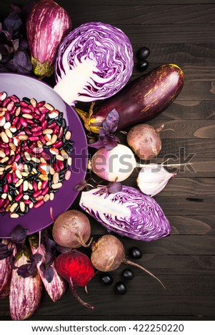 Purple vegetables on a wooden background