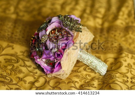 Purple wedding bouquet covered with crystals - stock photo