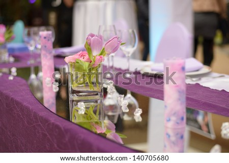 Purple wedding table decoration - stock photo