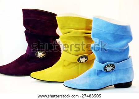 purple yellow and blue shoes against white background - stock photo