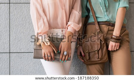 Purse detail with young women. - stock photo
