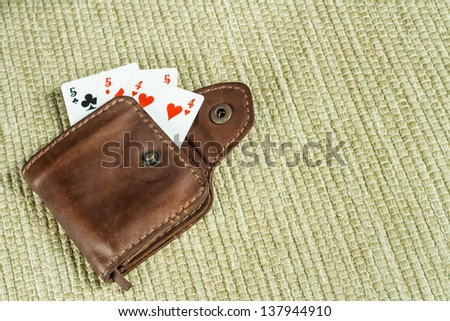 Purse made �¢??�¢??of leather and playing cards in high resolution - stock photo