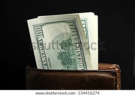 Purse with pack of dollars - stock photo
