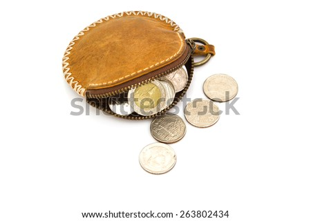 Purses and coins. On a white background. - stock photo
