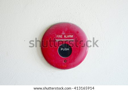Push button switch fire alarm on the wall - stock photo