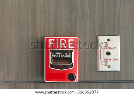 Push button switch fire and telephone on wood background