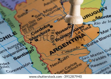 push pin on  a world map marking Argentina  as a destination concept