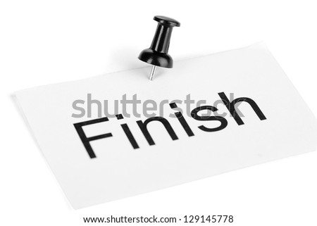 Push pin on paper with word finish written on it isolated on white