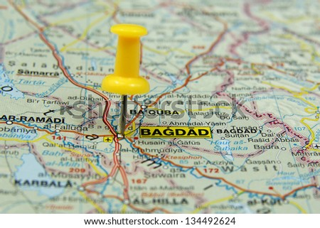 push pin pointing at Baghdad, Iraq - stock photo