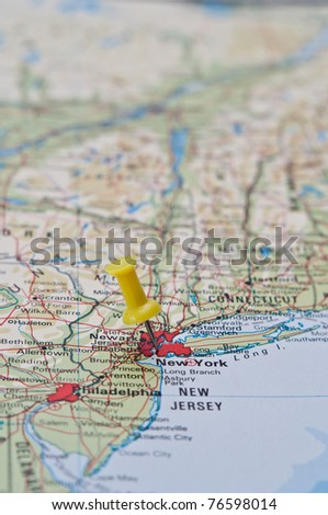 Push pin pointing at New York, United States on a map - stock photo