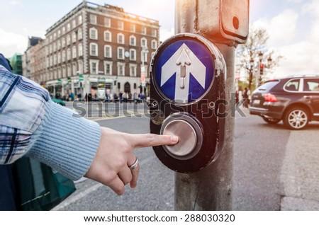 Push this button to cross. Dublin, Ireland. - stock photo