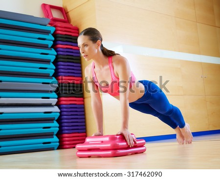 Push up push-ups woman exercise workout at gym indoor - stock photo