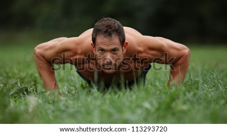 Push ups in the grass - stock photo
