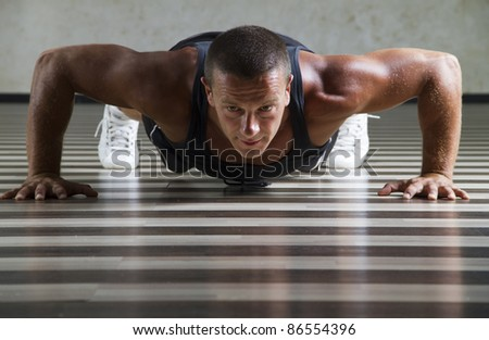 Push-ups on the floor of the gym - stock photo
