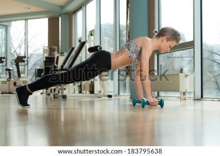Push-Ups Upper Position - Beautiful Fit Woman Doing Push ups In Healthy Club