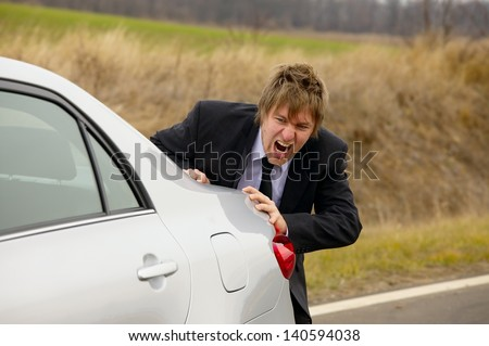 Pushing a broken down car - stock photo