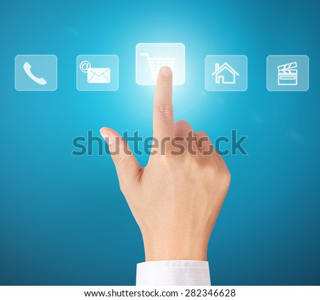 pushing a button on a touch screen interface  - stock photo