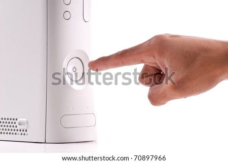 Pushing The Power Button - stock photo
