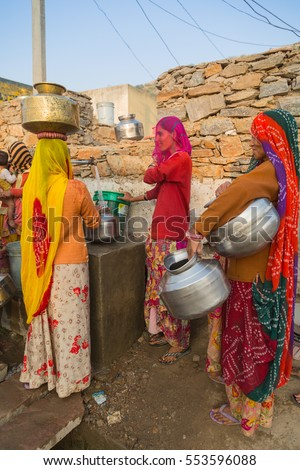 Pushkar, India Nov 2015- Unidentified locals fetching water from a communal water pipe